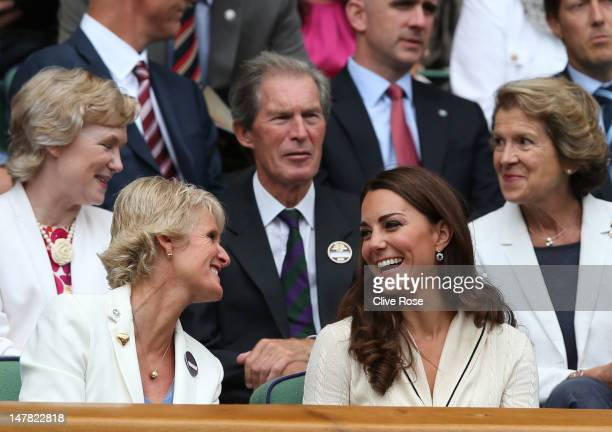 Catherine Duchess of Cambridge looks on from the Royal Box on Centre Court during day nine of the Wimbledon Lawn Tennis Championships at the All...