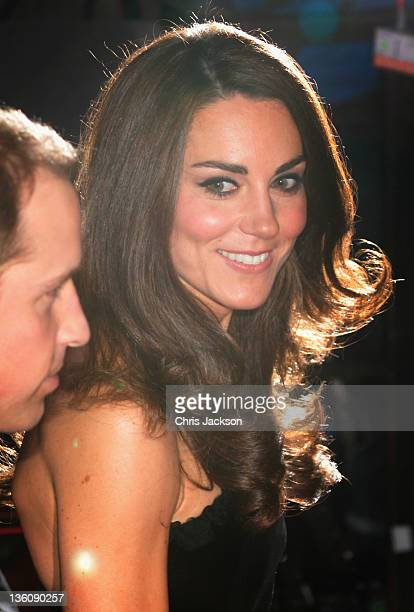 Catherine, Duchess of Cambridge looks towards Prince William, Duke of Cambridge as they attend the Sun Military Awards at the Imperial War Museum on...