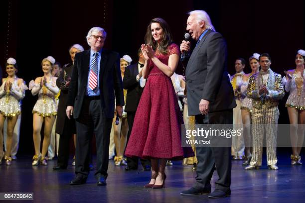 Catherine Duchess of Cambridge Lord Michael grade and Michael linnit take part in a presentation during the Opening Night Royal Gala performance of...