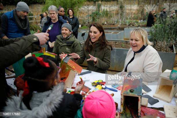 Catherine, Duchess of Cambridge makes bird boxes as she visits Islington Community Garden on January 15, 2019 in London, England.