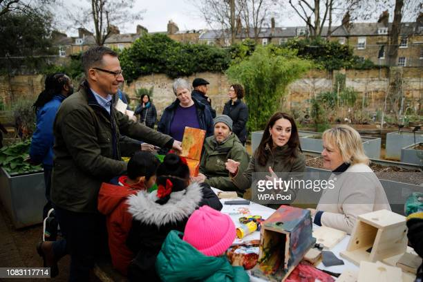 Catherine Duchess of Cambridge makes bird boxes as she visits Islington Community Garden on January 15 2019 in London England