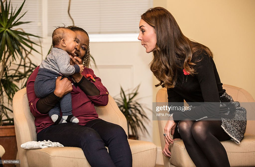 Catherine, Duchess of Cambridge makes faces at 4-month-old Gabriel as she talks to his mother Hlengiwe Sithole during a visit to the Nelson Trust Women's Centre on November 4, 2016 in Gloucester, England. The Women's Centre was set up in 2010 and is designed to support women who have vulnerabilities, particularly those who have experienced abuse and trauma. Along with a second site in Swindon the Women's Centre supports over 500 women annually, across Gloucestershire, Somerset and Wiltshire. During the visit Her Royal Highness will meet with members of staff and will also be introduced to women who have accessed the centre's vital support.