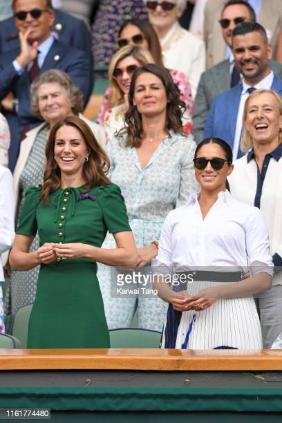 Catherine Duchess of Cambridge Martina Navratilova and Meghan Duchess of Sussex in the Royal Box on Centre Court during day twelve of the Wimbledon...