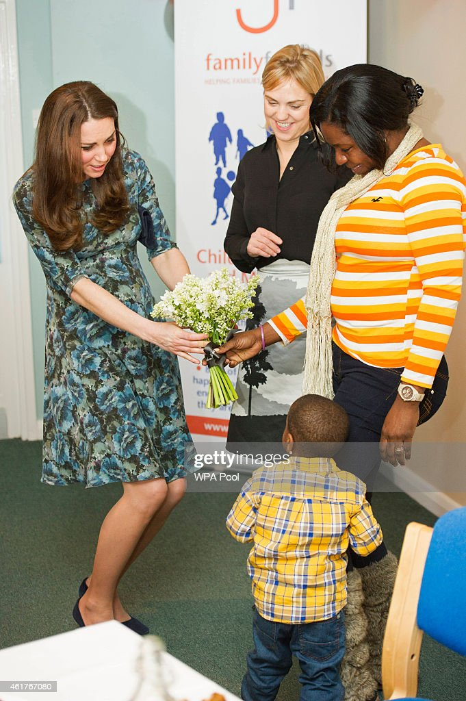Catherine, Duchess of Cambridge meets 2-year-old Ryan and his mother Tracy Dixon who presented her with flowers as she attends a coffee morning at Family Friends in Kensington on January 19, 2015 in London, England. Family Friends is a voluntary organisation to help families in deprived areas of the borough of Kensington.