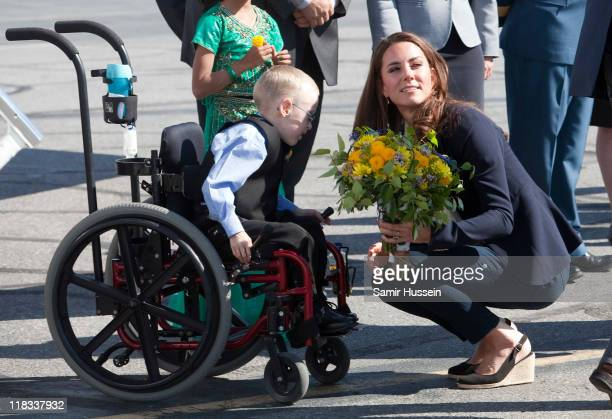 Catherine, Duchess of Cambridge meets a young boy in a wheelchair as she departs from Yellowknife airport on July 6, 2011 in Yellowknife, Canada.
