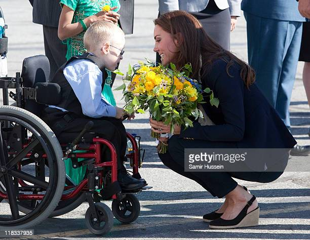 Catherine Duchess of Cambridge meets a young boy in a wheelchair as she departs from Yellowknife airport on July 6 2011 in Yellowknife Canada