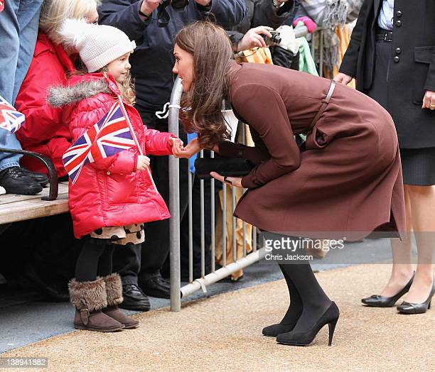 Catherine Duchess of Cambridge meets a young girl as she visits Alder Hey Children's NHS Foundation Trust on February 14 2012 in Liverpool England...