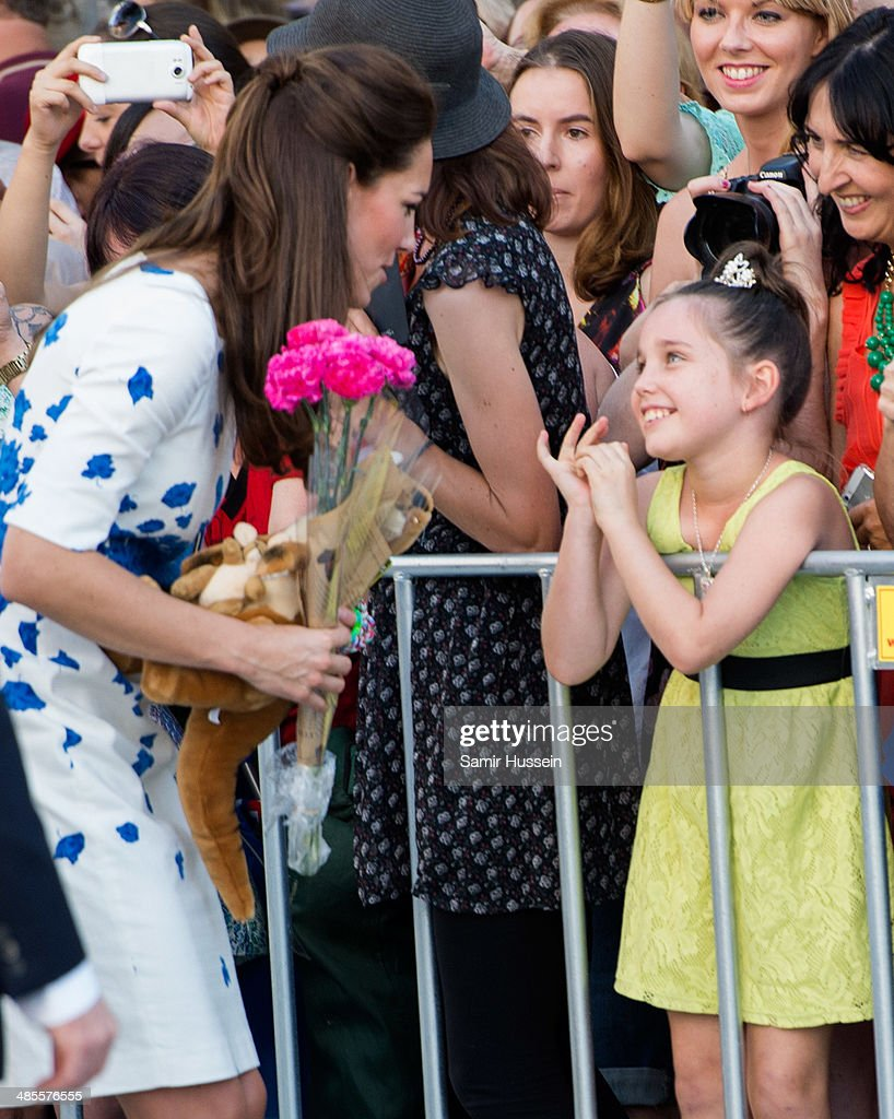 Catherine, Duchess of Cambridge meets a young girl during a walkabout on April 19, 2014 in Brisbane, Australia. The Duke and Duchess of Cambridge are on a three-week tour of Australia and New Zealand, the first official trip overseas with their son, Prince George of Cambridge.
