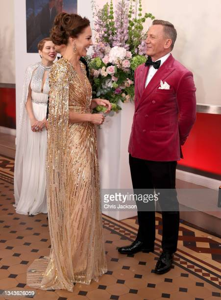 """Catherine, Duchess of Cambridge meets actor Daniel Craig as she attends the """"No Time To Die"""" World Premiere at Royal Albert Hall on September 28,..."""
