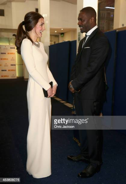 Catherine, Duchess of Cambridge meets actor Idris Elba as they attend the Royal film performance of 'Mandela: Long Walk to Freedom' at Odeon...