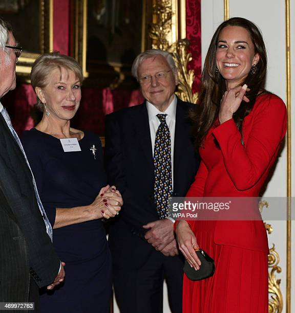 Catherine Duchess of Cambridge meets actress Dame Helen Mirren as Sir David Attenborough looks on during the Dramatic Arts reception at Buckingham...