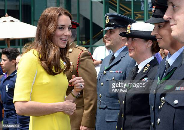 Catherine Duchess of Cambridge meets armed forces personnel during a visit to the Wimbledon Lawn Tennis Championships at the All England Lawn Tennis...