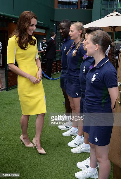 Catherine, Duchess of Cambridge meets ball boys and girls, from left, Dominic Barnaby, Olivia Mallett, Thomas Morais and Anissa Mayouf, during a...
