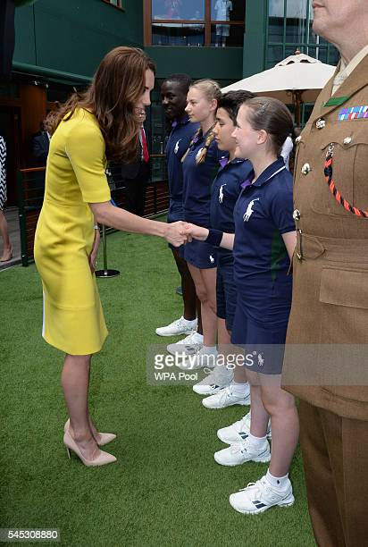 Catherine Duchess of Cambridge meets ball boys and girls from left Dominic Barnaby Olivia Mallett Thomas Morais and Anissa Mayouf during a visit to...
