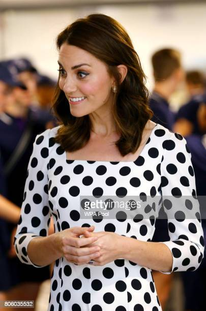 Catherine Duchess of Cambridge meets ball boys and girls on day one of the Wimbledon Championships at The All England Lawn Tennis and Croquet Club in...