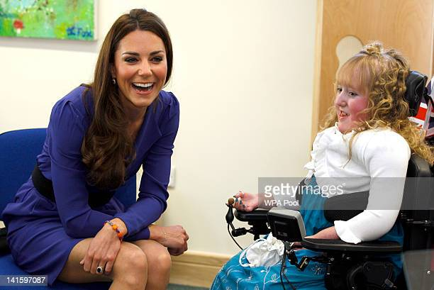 Catherine Duchess of Cambridge meets Bethany Woods in a music class during a visit to open The Treehouse Children's Hospice on March 19 2012 in...