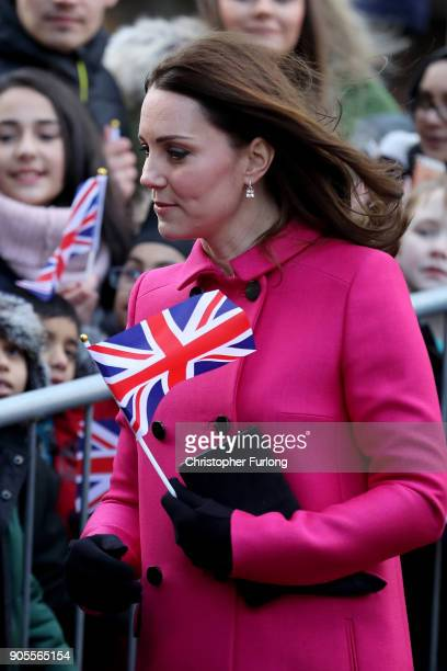 Catherine Duchess of Cambridge meets children as she arrives for a visit to Coventry Cathedral during their visit to the city on January 16 2018 in...