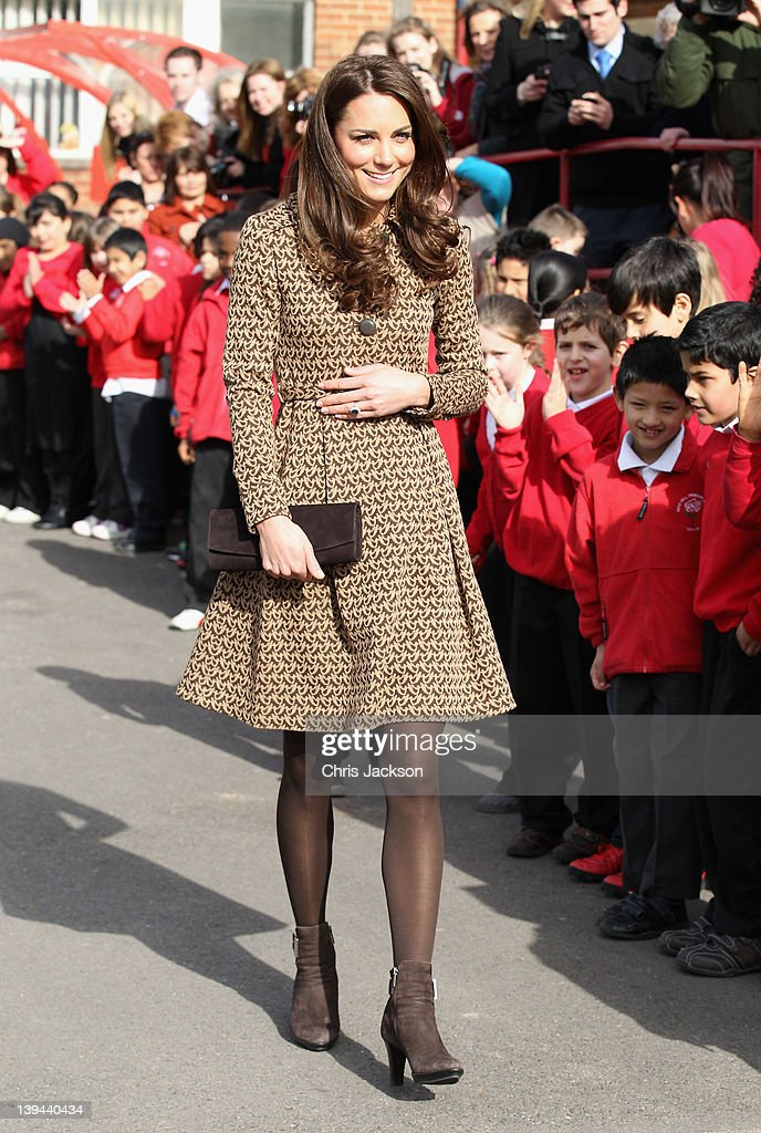 Catherine, Duchess of Cambridge meets children as she leaves Rose Hill Primary School during a visit to Oxford on February 21, 2012 in Oxford, England. The visit is in association with the charity Art Room who work with children to increase self-confidence and self-esteem