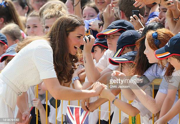 Catherine, Duchess of Cambridge meets children as she visits Gardens by the Bay on day 2 of Prince William, Duke of Cambridge and Catherine, Duchess...