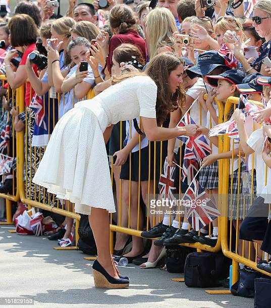 Catherine Duchess of Cambridge meets children as she visits Gardens by the Bay on day 2 of Prince William Duke of Cambridge and Catherine Duchess of...