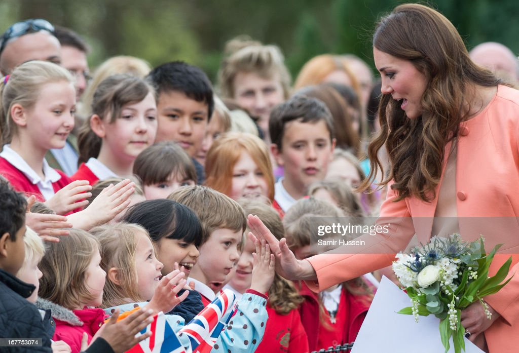 Catherine, Duchess of Cambridge meets children as she visits Naomi House on April 29, 2103 near Winchester, England.