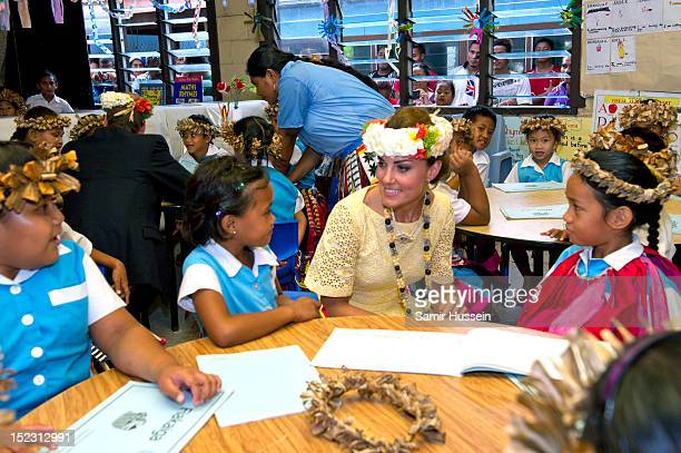 Catherine Duchess of Cambridge meets children at Nauti Primary School during the Royal couple's Diamond Jubilee tour of the Far East on September 18...
