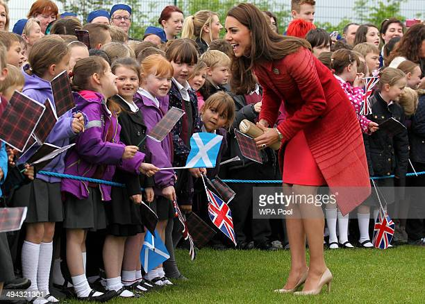 Catherine Duchess of Cambridge meets children during a visit to Strathearn Community Campus on May 29 2014 in Crieff Scotland The Duke and Duchess of...