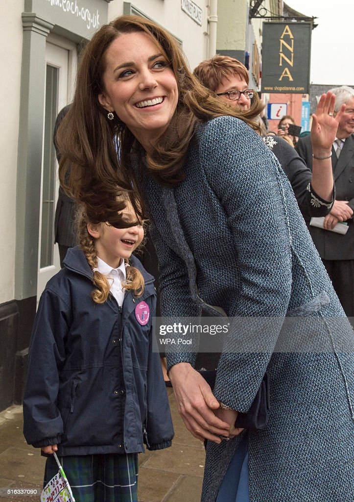 Catherine, Duchess of Cambridge meets children from a local school as she arrives to officially open the new EACH charity shop on March 18, 2016 in Holt, United Kingdom.