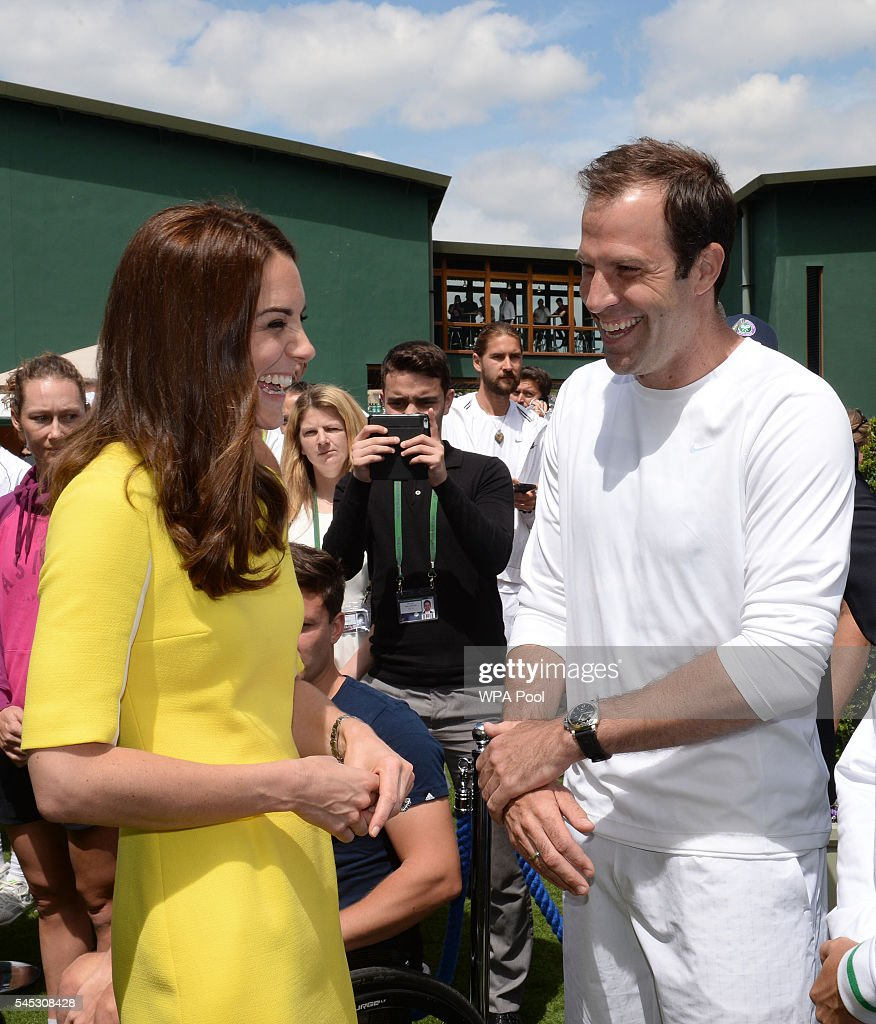 Catherine, Duchess of Cambridge meets former tennis player Greg Rusedski during a visit to the Wimbledon Lawn Tennis Championships at the All England Lawn Tennis and Croquet Club on July 7, 2016 in London, England.