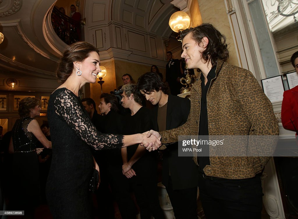 Catherine, Duchess of Cambridge meets Harry Styles of boy band One Direction at The Royal Variety Performance at the London Palladium on November 13, 2014 in London, England.