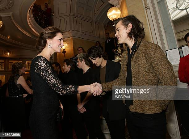 Catherine, Duchess of Cambridge meets Harry Styles of boy band One Direction at The Royal Variety Performance at the London Palladium on November 13,...