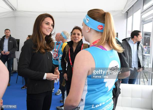 Catherine, Duchess of Cambridge meets Heads Together runners in the Blue Start area as they prepare for the 2017 Virgin Money London Marathon on...