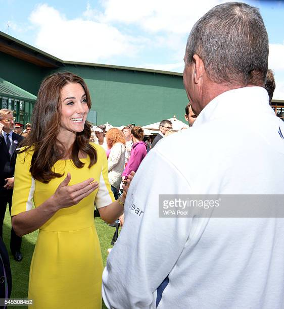Catherine Duchess of Cambridge meets Ivan Lendl Andy Murray's coach during a visit to the Wimbledon Lawn Tennis Championships at the All England Lawn...