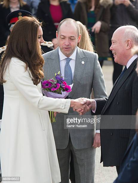 Catherine Duchess of Cambridge meets Julian Fellowes as she visits the set of Downton Abbey at Ealing Studios on an official visit on March 12 2015...