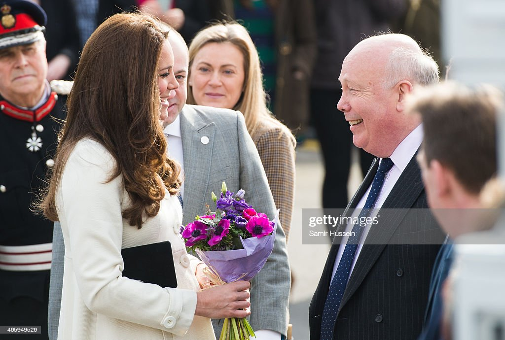 Catherine, Duchess of Cambridge meets Julian Fellowes (R) as she visits the set of Downton Abbey at Ealing Studios on an official visit on March 12, 2015 in London, England.
