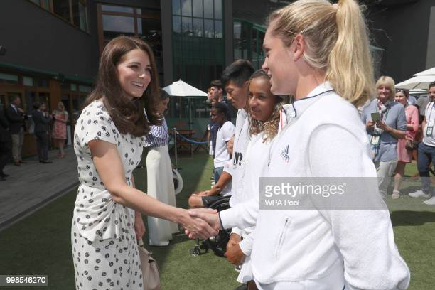 Catherine Duchess of Cambridge meets junior player Caty McNally of the United States during a visit to the Wimbledon Championships at All England...