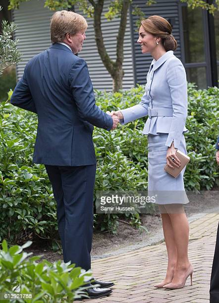 Catherine, Duchess of Cambridge meets King Willem Alexander of the Netherlands at Villa Eikenhorst on October 11, 2016 in The Hague, Netherlands.
