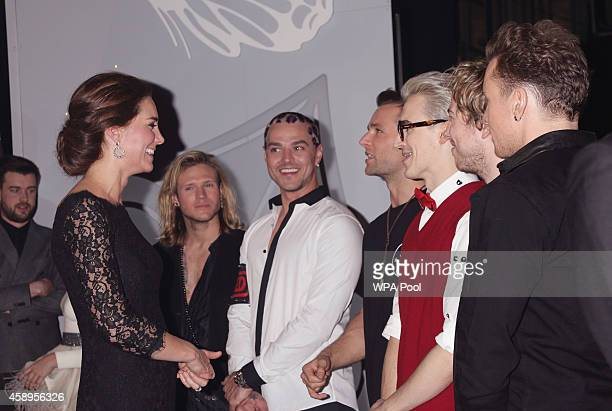 Catherine Duchess of Cambridge meets members of McBusted at the end of The Royal Variety Performance at the London Palladium on November 13 2014 in...
