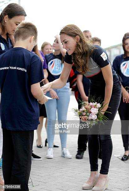 Catherine Duchess of Cambridge meets members of the 1851 Trust during a visit to Land Rover BAR at the America's Cup World Series on July 24 2016 in...