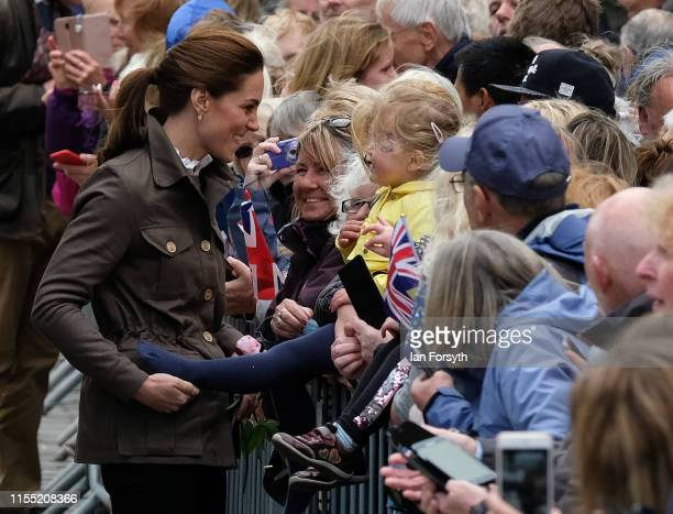Catherine Duchess of Cambridge meets members of the public as she and Prince William Duke of Cambridge visit Keswick Market place during a visit to...