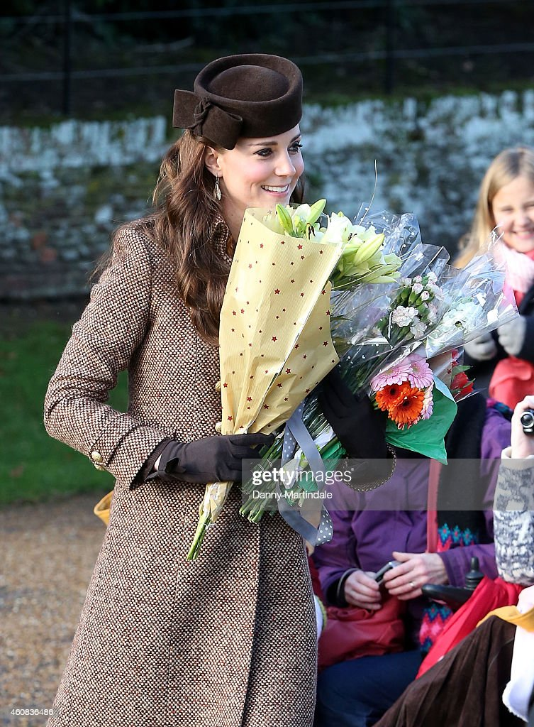 Catherine, Duchess of Cambridge meets members of the public as they leave the Christmas Day Service at Sandringham Church on December 25, 2014 in King's Lynn, England.
