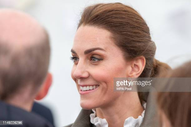 Catherine Duchess of Cambridge meets members of the public they visit Keswick Market place during a visit to Cumbria on June 11 2019 in Keswick...