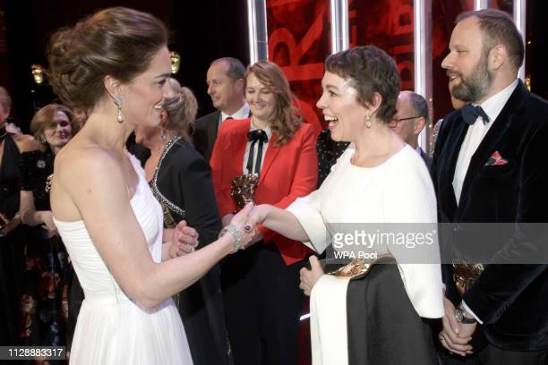 Catherine Duchess of Cambridge meets Olivia Colman and director Yorgas Lanthimos 2nd right and writer Tony McNamara right after the following the EE...