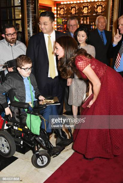 Catherine Duchess of Cambridge meets Ollie Duell at the Opening Night Royal Gala performance of '42nd Street' in aid of the East Anglia Children's...