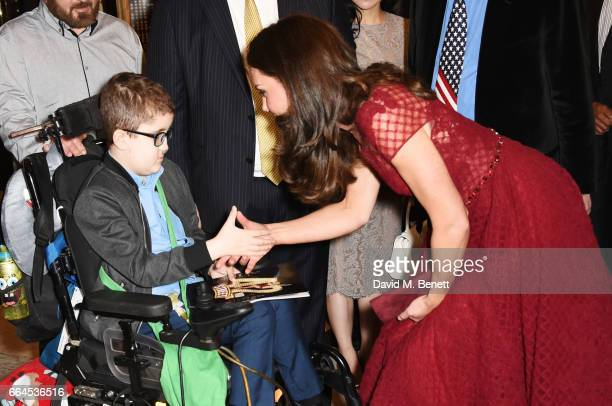 Catherine Duchess of Cambridge meets Ollie Duell at the Opening Night Royal Gala performance of 42nd Street in aid of the East Anglia Children's...