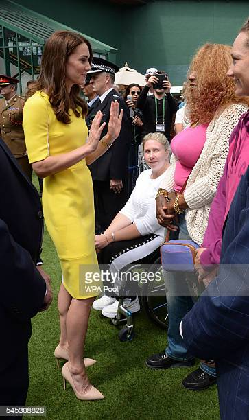 Catherine Duchess of Cambridge meets Oracene Price the mother of Venus and Serena Williams during a visit to the Wimbledon Lawn Tennis Championships...