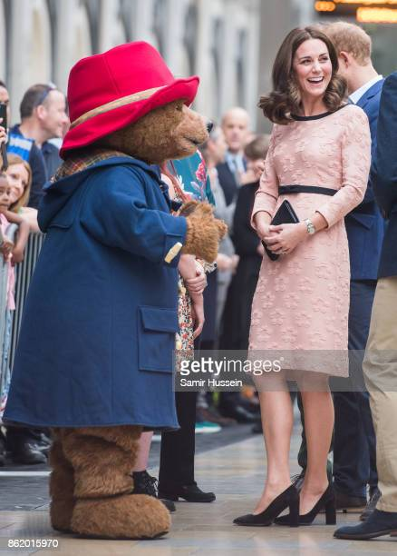 Catherine Duchess of Cambridge meets Paddington Bear as she attends the Charities Forum Event on board the Belmond Britigh Pullman train at...