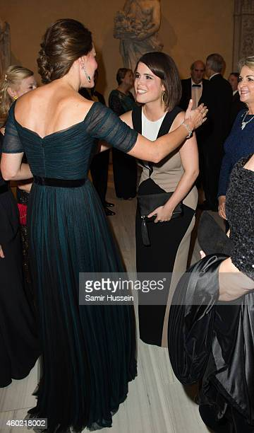 Catherine Duchess of Cambridge meets Princess Eugenie of York at the St Andrews 600th Anniversary Dinner on December 9 2014 in New York City