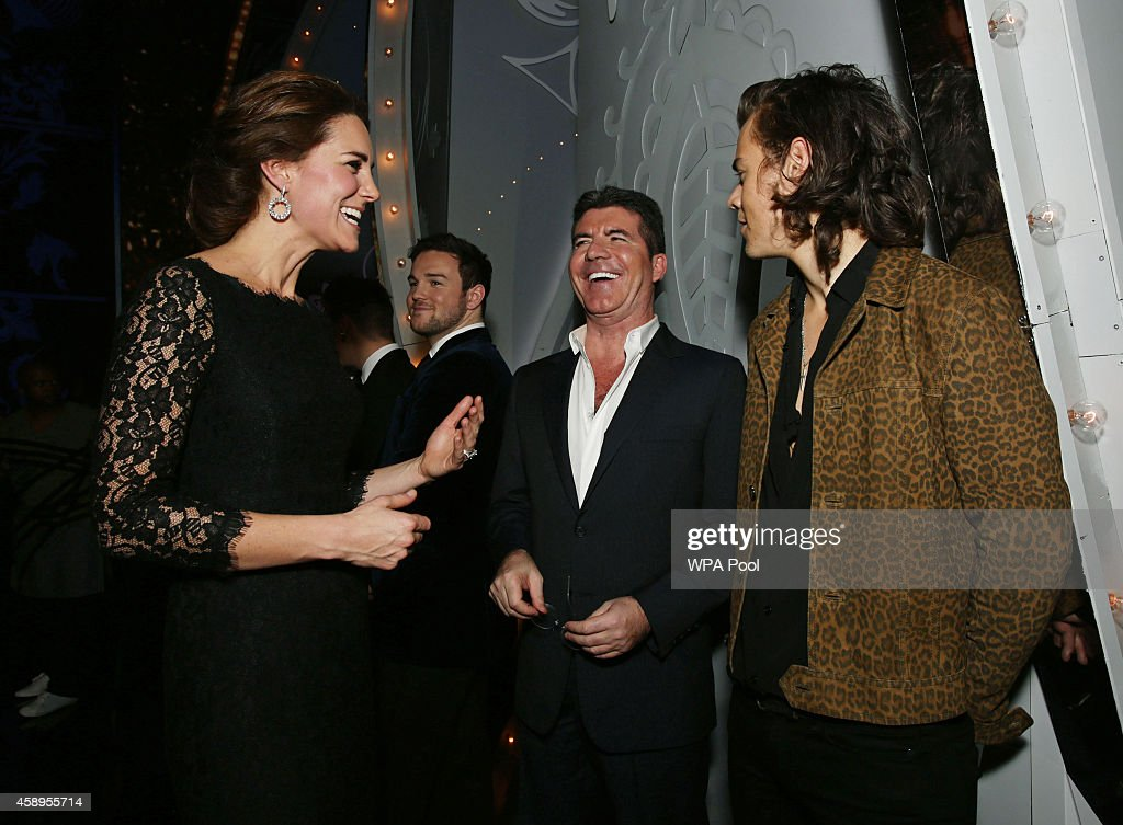Catherine, Duchess of Cambridge meets Simon Cowell and Harry Styles of One Direction at the end of The Royal Variety Performance at the London Palladium on November 13, 2014 in London, England.