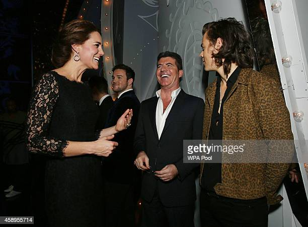 Catherine Duchess of Cambridge meets Simon Cowell and Harry Styles of One Direction at the end of The Royal Variety Performance at the London...